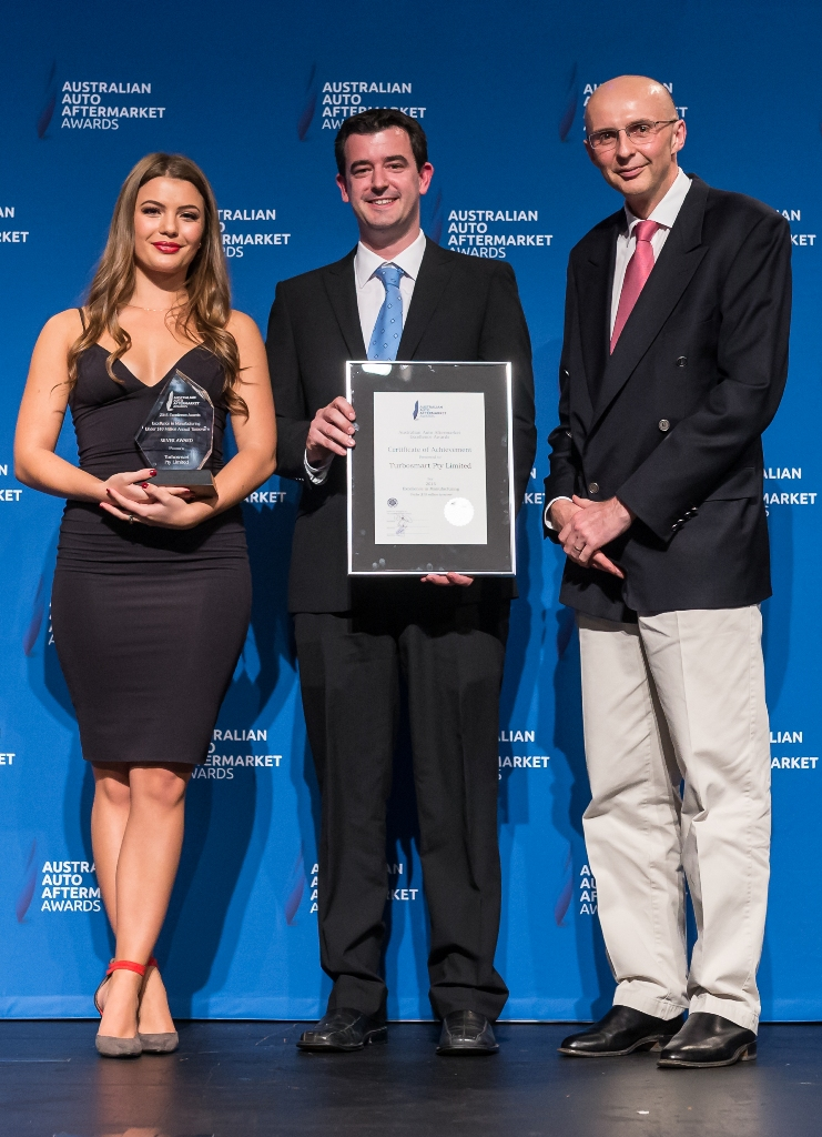 Stewart Mahony, centre, accepting an award on behalf of Turbosmart at the Australian Auto Aftermarket Awards 2015.